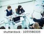 members of a business team... | Shutterstock . vector #1055580335