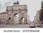 the siegestor in munich ... | Shutterstock . vector #1055586608