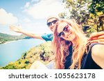 young happy couple doing selfie ... | Shutterstock . vector #1055623178