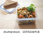 lunch in a plastic container.... | Shutterstock . vector #1055636918