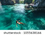 young woman swimming in clear...   Shutterstock . vector #1055638166