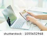 accounting analyst calculate... | Shutterstock . vector #1055652968