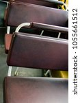 Small photo of passenger seat in old city bus. On these chairs sat thousands of passengers