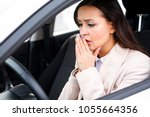 closeup shot of stressed young... | Shutterstock . vector #1055664356