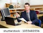 a young  manager working on a... | Shutterstock . vector #1055683556