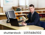 a young  manager working on a... | Shutterstock . vector #1055686502