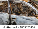 Small photo of Burned Out Motorcar interior and exterior
