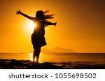 silhouette of happy girl... | Shutterstock . vector #1055698502