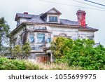 old abandoned farm house with... | Shutterstock . vector #1055699975
