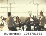 group of a young business... | Shutterstock . vector #1055701988
