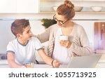 take a break. delighted boy... | Shutterstock . vector #1055713925