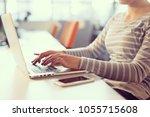young female entrepreneur... | Shutterstock . vector #1055715608