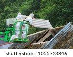 removal of fiber cement... | Shutterstock . vector #1055723846