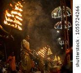 Small photo of VARANASI, INDIA - MAR 23, 2018: Hindu priests perform Agni Pooja (Sanskrit: Worship of Fire) on Dashashwamedh Ghat - main and oldest ghat of Varanasi located on the Ganges.