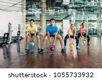 full length view of four fit... | Shutterstock . vector #1055733932