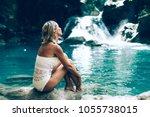 young woman enjoying natural... | Shutterstock . vector #1055738015