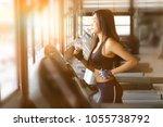 woman cardio on treadmill in...   Shutterstock . vector #1055738792