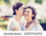 portrait of thankful teenage... | Shutterstock . vector #1055741942