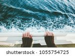 traveler holding hands above... | Shutterstock . vector #1055754725