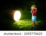crying child blond girl next to ...   Shutterstock . vector #1055770625