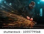 industrial worker with tools and sparks - stock photo