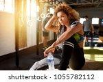 fit young brunette woman... | Shutterstock . vector #1055782112