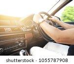 man driving car hand on...   Shutterstock . vector #1055787908