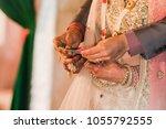 brides performing wedding... | Shutterstock . vector #1055792555