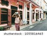 boho girl walking on the city... | Shutterstock . vector #1055816465