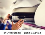 hand luggage compartment with... | Shutterstock . vector #1055823485