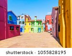 colorful houses burano island ... | Shutterstock . vector #1055828195