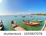 fishing boats in small port | Shutterstock . vector #1055837078