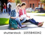 young happy students with books ... | Shutterstock . vector #1055840342