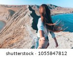 girl walking on the mountain... | Shutterstock . vector #1055847812