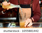 professional bartender is...   Shutterstock . vector #1055881442