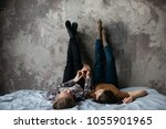young caucasian couple lying... | Shutterstock . vector #1055901965