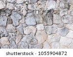 Small photo of Stone background. Closeup stonewall. Outdoos
