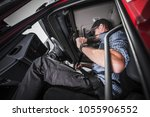 caucasian truck driver using... | Shutterstock . vector #1055906552