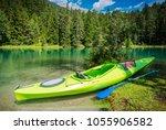 scenic kayak trip. green single ... | Shutterstock . vector #1055906582