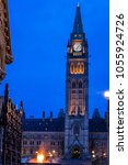 Small photo of View of Peace Tower and Centennial Flame at Parliament complex Ottawa, Canada