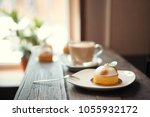 on the wooden table there is a... | Shutterstock . vector #1055932172