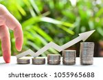 coins saving increase to high... | Shutterstock . vector #1055965688