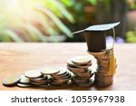hat graduation model on coins... | Shutterstock . vector #1055967938