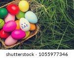 row of easter eggs in fresh... | Shutterstock . vector #1055977346