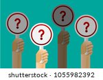 hands holding question marks...   Shutterstock .eps vector #1055982392