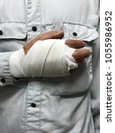male worker who injured his... | Shutterstock . vector #1055986952