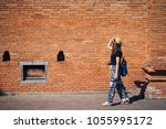 young asian woman traveler with ... | Shutterstock . vector #1055995172