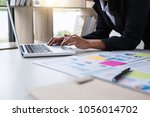 businesswoman or accountant... | Shutterstock . vector #1056014702