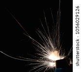 lighter ignition close up sparks | Shutterstock . vector #1056029126