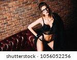 seductive girl in the sexy... | Shutterstock . vector #1056052256
